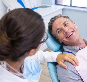 happy patient in dentist chair